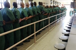 fema-prisoners-boarding-busses-300x199