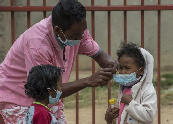 Face masks are placed on children in Antananarivo, Madagascar (AP Photo/Alexander JOE)