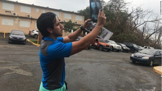 Dr. Trivino must use sunlight to examine x-rays since electricity is sporadic in Puerto Rico.