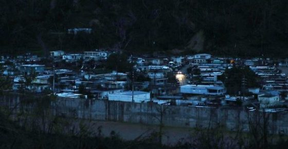 A lone car provides the only source of light in devastated Puerto Rico city of Utuado.